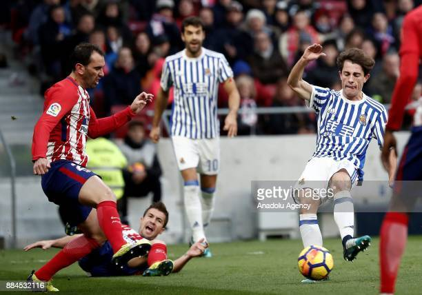 Diego Godin of Atletico de Madrid in action against Alvaro Odriozola of Real Sociedad during the La Liga match between Club Atletico Madrid and Real...