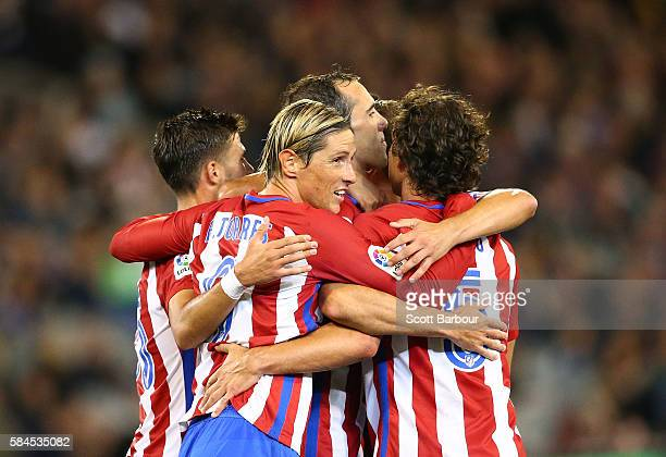 Diego Godin of Atletico de Madrid is congratulated by Fernando Torres and his teammates after scoring their first goal during 2016 International...