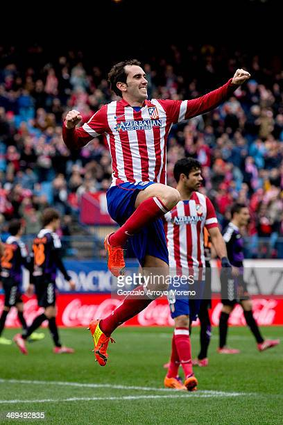 Diego Godin of Atletico de Madrid jumps celebrating scoring their third goal during the La Liga match between Club Atletico de Madrid and Real...