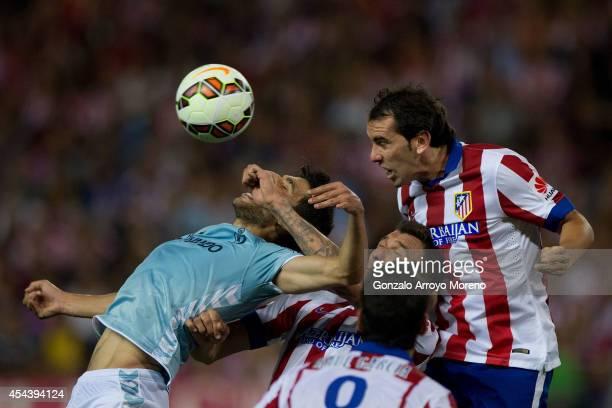 Diego Godin of Atletico de Madrid saves on a header behind Eneko Boveda Altube of SD Eibar during the La Liga match between Club Atletico de Madrid...