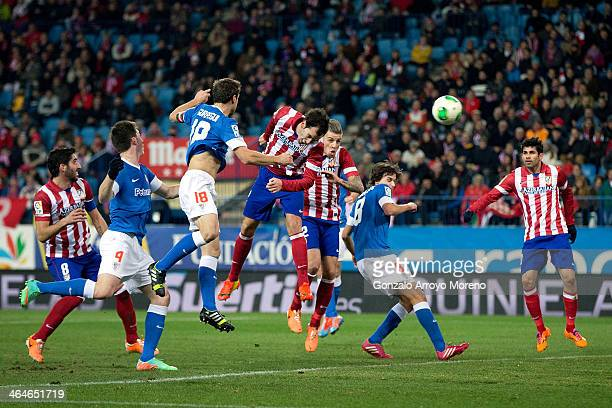 Diego Godin of Atletico de Madrid scores their opening goal from a header during the Copa del Rey Quarter Final first leg match between Club Atletico...