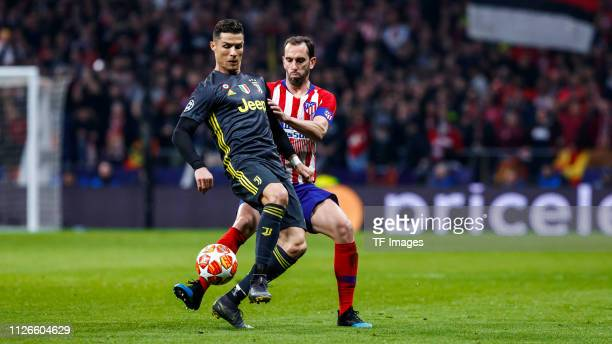 Diego Godin of Atletico Madrid and Cristiano Ronaldo of Juventus battle for the ball during the UEFA Champions League Round of 16 First Leg match...