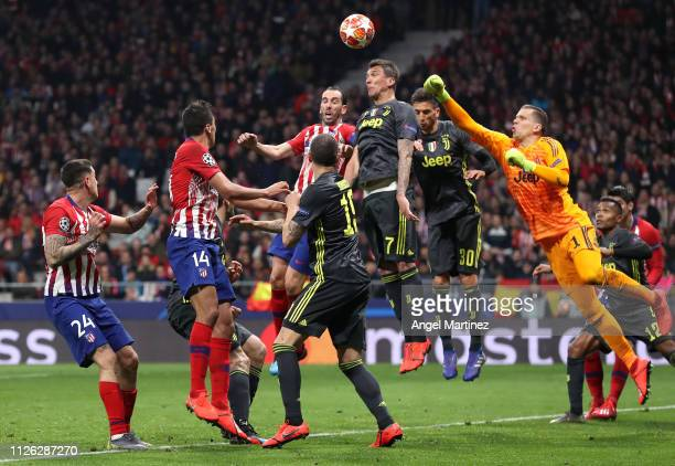 Diego Godin of Atletico Madrid and Mario Mandzukic of Juventus compete for a header during the UEFA Champions League Round of 16 First Leg match...