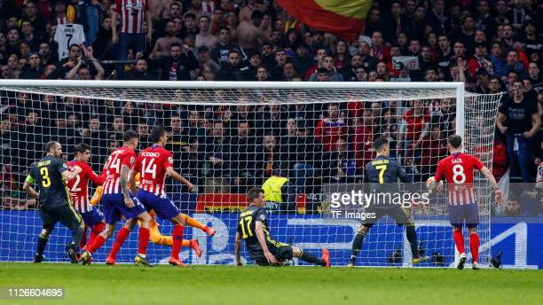 Diego Godin of Atletico Madrid celebrates after scoring his team's second goal during the UEFA Champions League Round of 16 First Leg match between...