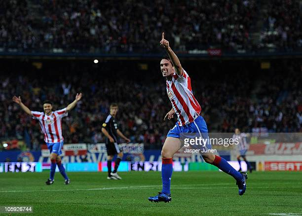 Diego Godin of Atletico Madrid celebrates scoring his sides opening goal during the UEFA Europa League group B match between Atletico Madrid and...