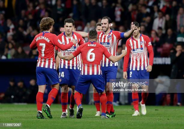 Diego Godin of Atletico Madrid celebrates with teammates after scoring his team's first goal during the La Liga match between Club Atletico de Madrid...
