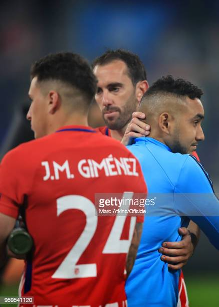 Diego Godin of Atletico Madrid consoles Dimitri Payet of Olympique de Marseille during the UEFA Europa League Final between Olympique de Marseille...