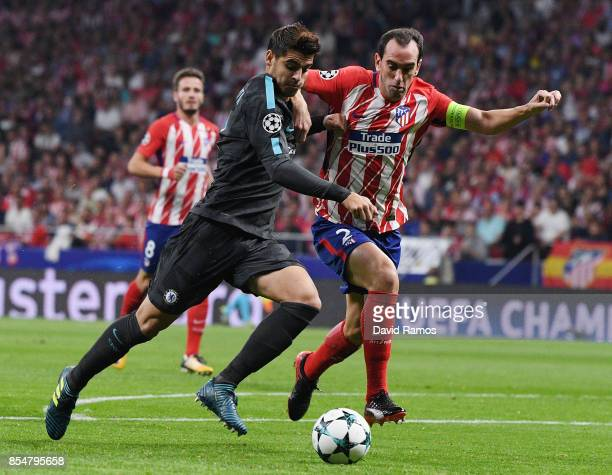 Diego Godin of Atletico Madrid holds off Alvaro Morata of Chelsea during the UEFA Champions League group C match between Atletico Madrid and Chelsea...