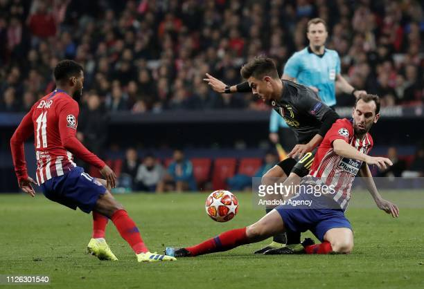 Diego Godin of Atletico Madrid in action against Paulo Dybala of Juventus during UEFA Champions League round of 16 soccer match between Atletico...