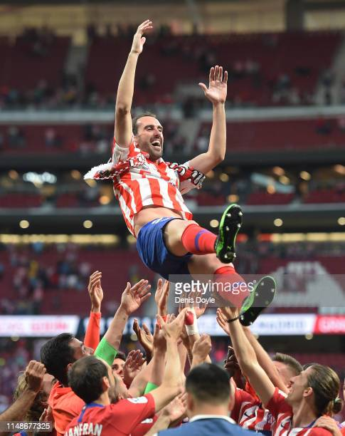 Diego Godin of Atletico Madrid is thrown into the air by his teammates during celebrations after his last home match for the club at the end of the...