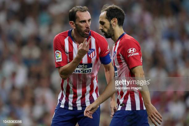 Diego Godin of Atletico Madrid, Juanfran of Atletico Madrid during the La Liga Santander match between Real Madrid v Atletico Madrid at the Santiago...