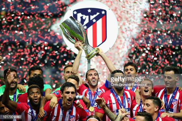 Diego Godin of Atletico Madrid lifts the trophy and celebrates with his team after winning the UEFA Super Cup between Real Madrid and Atletico Madrid...