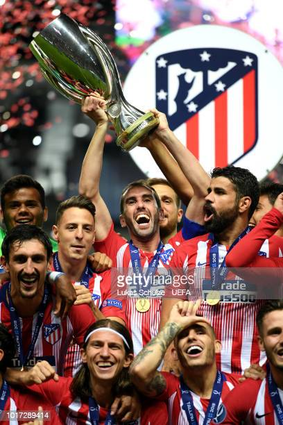 Diego Godin of Atletico Madrid lifts the trophy as Atletico Madrid celebrate victory in the UEFA Super Cup between Real Madrid and Atletico Madrid at...