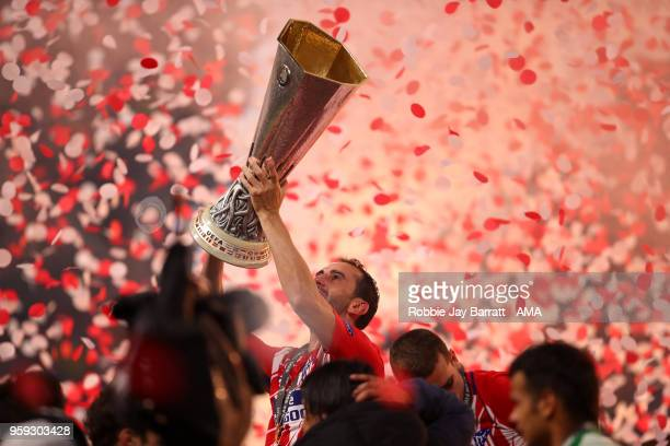 Diego Godin of Atletico Madrid lifts the trophy at the end of the UEFA Europa League Final between Olympique de Marseille and Club Atletico de Madrid...