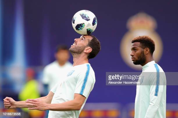 Diego Godin of Atletico Madrid plays with the ball whilst his team mate Thomas Lemar looks on during a training session ahead of the UEFA Super Cup...