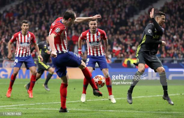 Diego Godin of Atletico Madrid scores his team's second goal during the UEFA Champions League Round of 16 First Leg match between Club Atletico de...