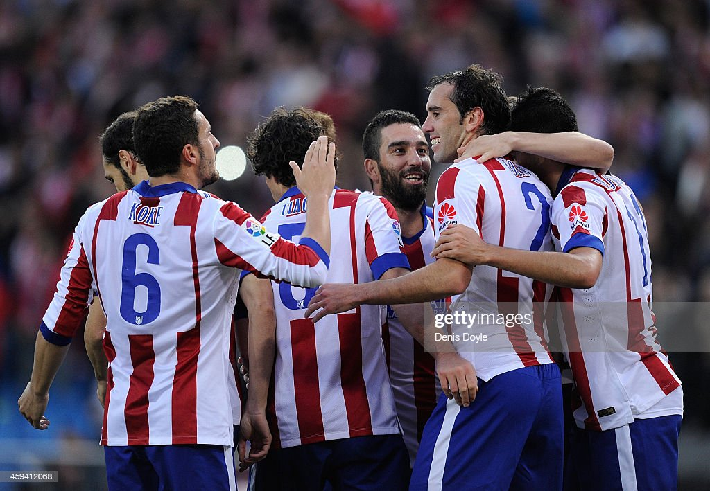 Diego Godin (#2) of Club Atletico de Madrid celebrates after scoring his team's 3rd goal during the La Liga match between Club Atletico de Madrid and Malaga CF at Vicente Calderon Stadium on November 22, 2014 in Madrid, Spain.