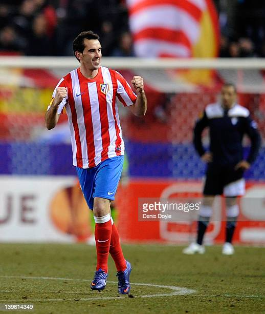 Diego Godin of Club Atletico de Madrid celebrates after scoring Atletico's opening goal during the UEFA Europa League Round of 32 second leg match...