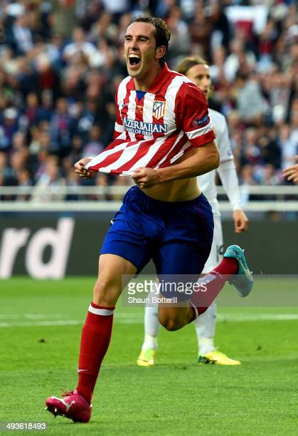 Diego Godin of Club Atletico de Madrid celebrates scoring the opening goal during the UEFA Champions League Final between Real Madrid and Atletico de...