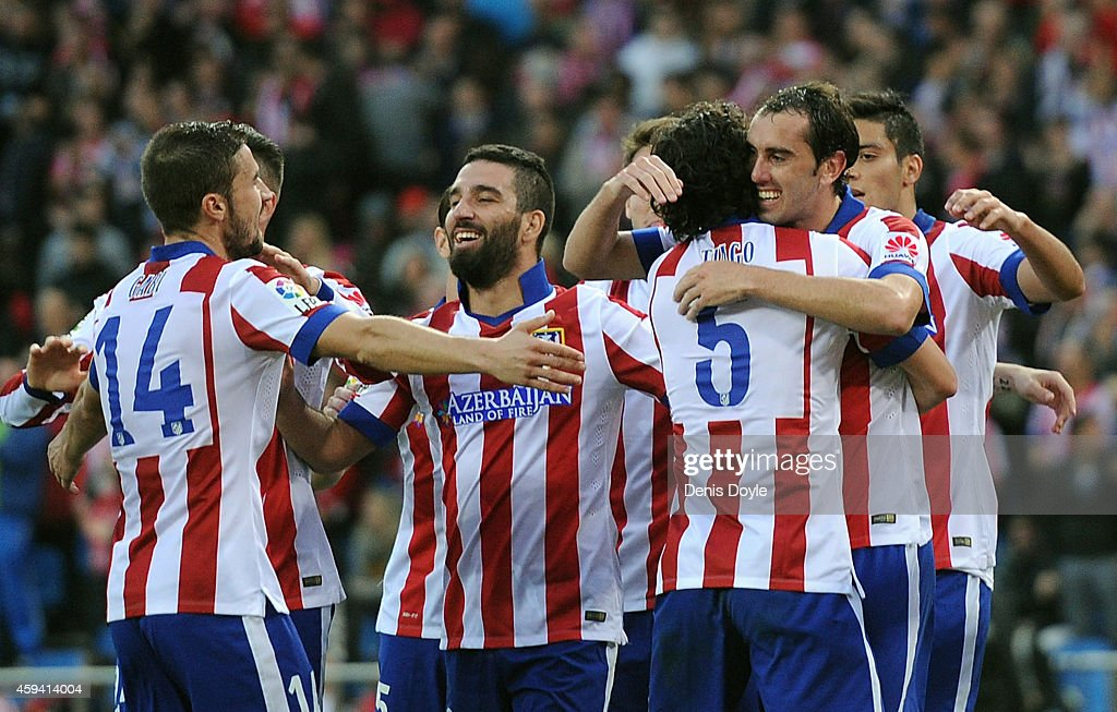 Diego Godin (R) of Club Atletico de Madrid celebrates with Tiago Mendes after scoring his team's 3rd goal during the La Liga match between Club Atletico de Madrid and Malaga CF at Vicente Calderon Stadium on November 22, 2014 in Madrid, Spain.