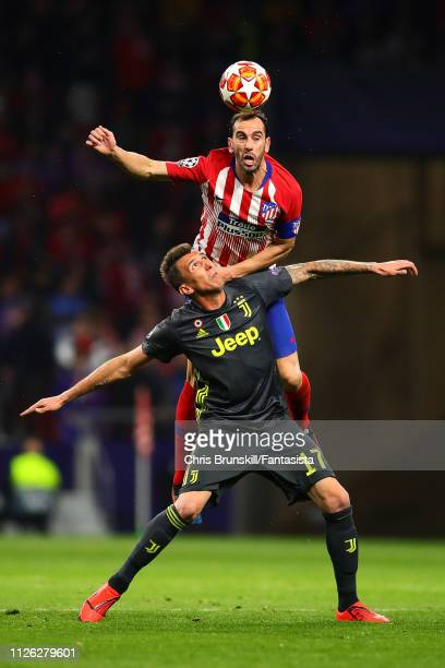 Diego Godin of Club Atletico de Madrid competes for the ball with Mario Mandzukic of Juventus during the UEFA Champions League Round of 16 First Leg...