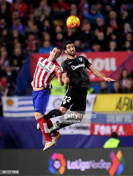 Diego Godin of Club Atletico de Madrid goes for a high ball against _Raul Garcia of Athletic Club during the La Liga match between Club Atletico de...