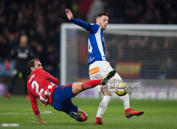 Diego Godin of Club Atletico de Madrid tackles Jorge Franco 'u2018'u2019Burgui'u2019'u2019 of Deportivo Alaves during the La Liga match between...