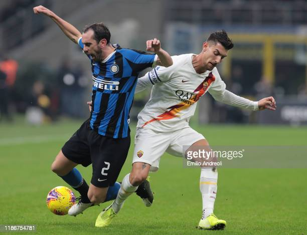 Diego Godin of FC Internazionale is challenged by Lorenzo Pellegrini of AS Roma during the Serie A match between FC Internazionale and AS Roma at...