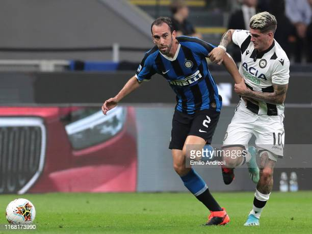 Diego Godin of FC Internazionale is challenged by Rodrigo De Paul of Udinese Calcio during the Serie A match between FC Internazionale and Udinese...