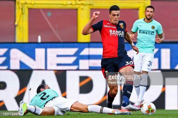 Diego Godin of Inter and Andrea Favilli of Genoa vie for the ball during the Serie A match between Genoa CFC and FC Internazionale at Stadio Luigi...