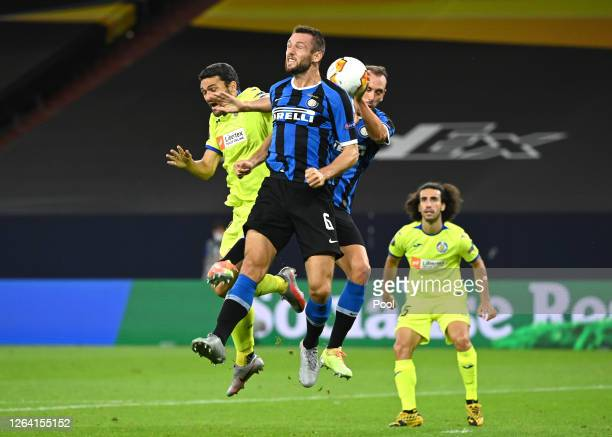 Diego Godin of Inter Milan appears to handle the ball inside the area leading to a penalty for Getafe during the UEFA Europa League round of 16...