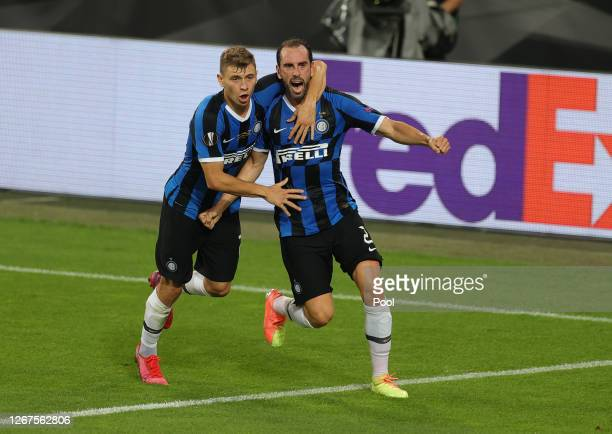 Diego Godin of Inter Milan celebrates with teammate Nicolo Barella after scoring his team's second goal during the UEFA Europa League Final between...
