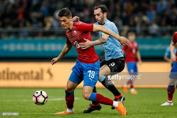 Diego Godin of Uruguay and Patrik Schick of Czech Republic compete for the ball during the 2018 China Cup International Football Championship match...