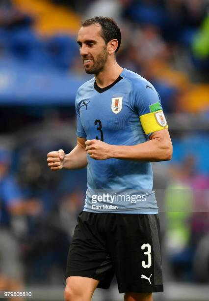 Diego Godin of Uruguay celebrates victory with team mates during the 2018 FIFA World Cup Russia group A match between Uruguay and Saudi Arabia at...