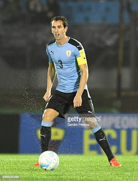 Diego Godin of Uruguay drives the ball during a match between Uruguay and Paraguay as part of FIFA 2018 World Cup Qualifiers at Centenario Stadium on...