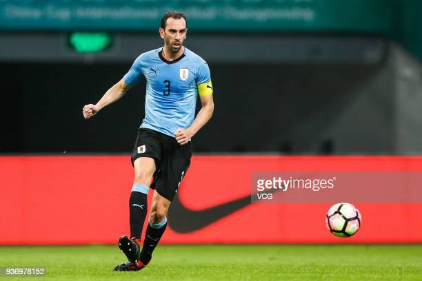 Diego Godin of Uruguay drives the ball during the 2018 China Cup International Football Championship match between Uruguay and Czech Republic at...