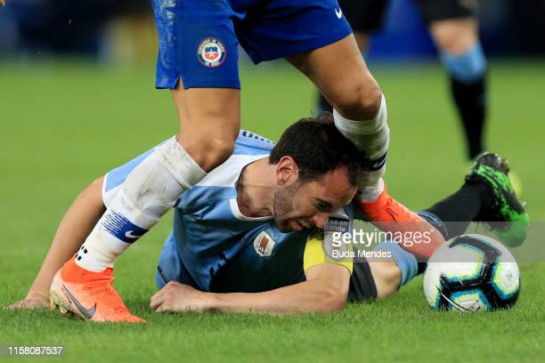 Diego Godin of Uruguay fights for the ball during the Copa America Brazil 2019 group C match between Chile and Uruguay at Maracana Stadium on June 24...