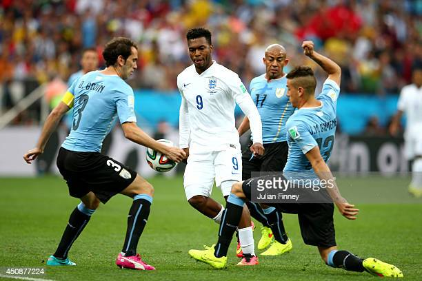 Diego Godin of Uruguay handles the ball as Daniel Sturridge of England looks on during the 2014 FIFA World Cup Brazil Group D match between Uruguay...