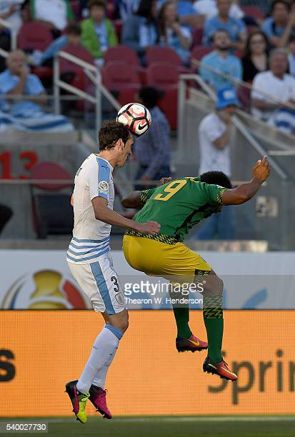 Diego Godin of Uruguay hit a header over the top of Giles Barnes of Jamaica during the 2016 Copa America Centenario Group match play between Uruguay...