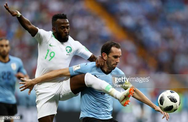 Diego Godin of Uruguay is challenged by Fahad Almuwallad of Saudi Arabia during the 2018 FIFA World Cup Russia group A match between Uruguay and...