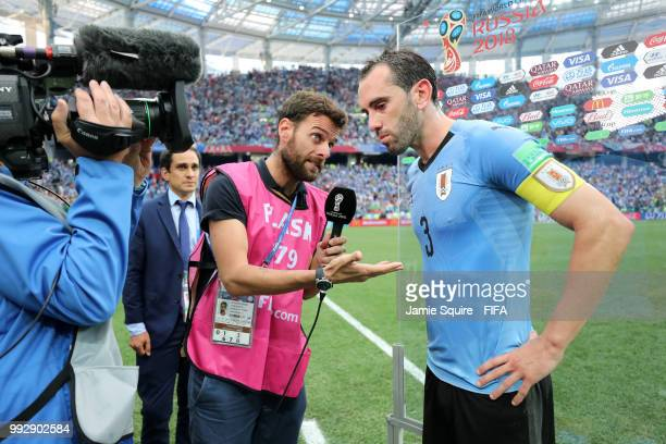Diego Godin of Uruguay is interviewed following the 2018 FIFA World Cup Russia Quarter Final match between Uruguay and France at Nizhny Novgorod...