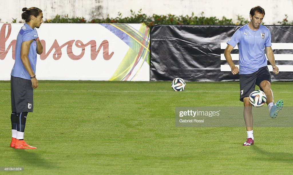 Diego Godin of Uruguay kicks the ball during a training session as part of the 2014 FIFA World Cup on June 27, 2014 in Rio de Janeiro, Brazil. Uruguay will face Colombia in a Round of 16 match as part of FIFA World Cup 2014 Brazil at Sao Januario Stadium on June 28.