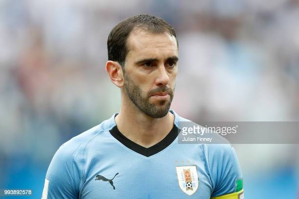 Diego Godin of Uruguay looks on during the 2018 FIFA World Cup Russia Quarter Final match between Winner Game 49 and Winner Game 50 at Nizhny...