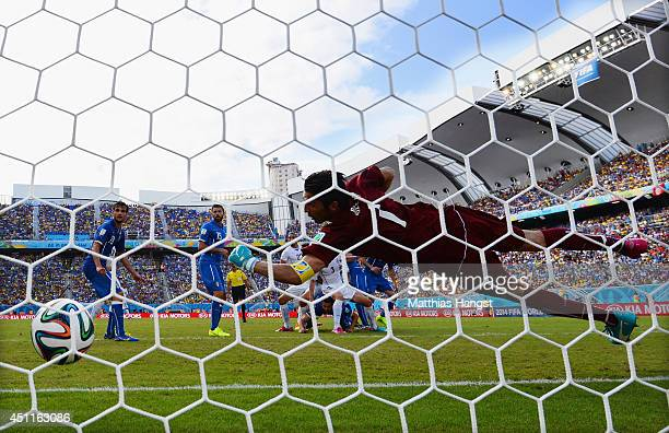 Diego Godin of Uruguay scores his team's first goal past goalkeeper Gianluigi Buffon of Italy during the 2014 FIFA World Cup Brazil Group D match...