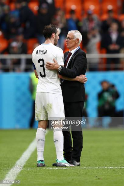 Diego Godin of Uruguay speaks with Hector Cuper, Head coach of Egypt following the 2018 FIFA World Cup Russia group A match between Egypt and Uruguay...
