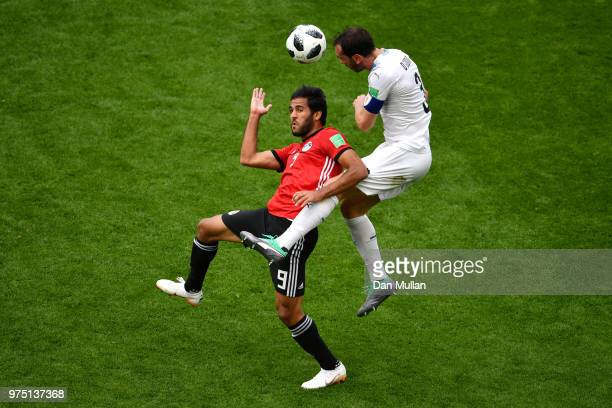 Diego Godin of Uruguay wins a header from Marwan Mohsen of Egypt during the 2018 FIFA World Cup Russia group A match between Egypt and Uruguay at...