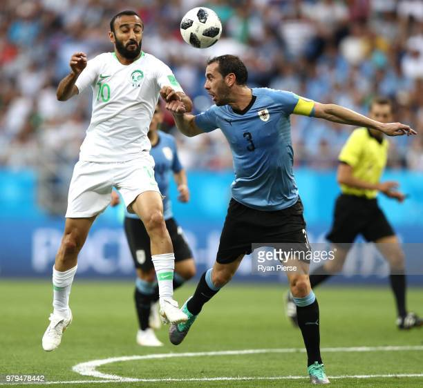 Diego Godin of Uruguay wins a header from Mohammed Alsahlawi of Saudi Arabia during the 2018 FIFA World Cup Russia group A match between Uruguay and...