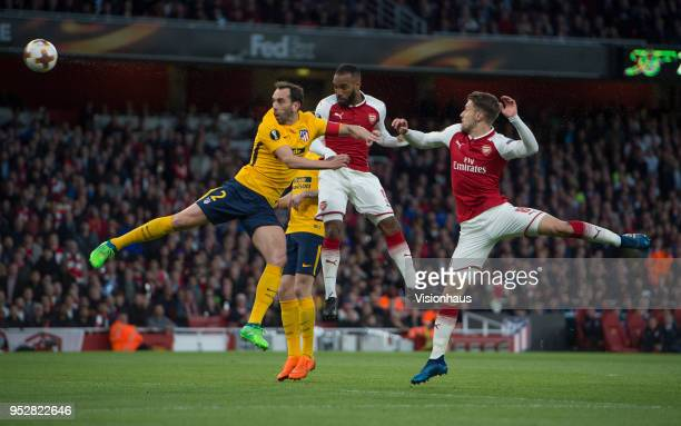 Diego Godín of Atletico Madrid and Alexandre Lacazette and Aaron Ramsey of Arsenal during the UEFA Europa League semifinal 1st Leg match between...