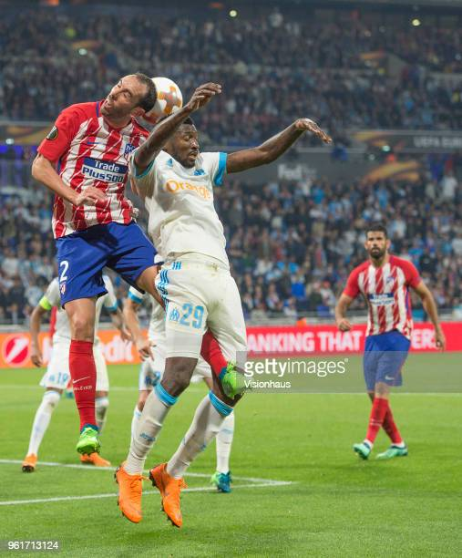 Diego Godín of Atletico Madrid and AndréFrank Zambo Anguissa of Marseille during the UEFA Europa League Final between Olympique de Marseille and Club...