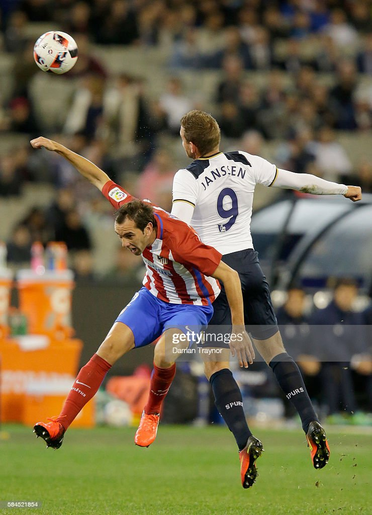 Diego Godn of Atletico Madrid and Vincent Janssen of Tottenham Hotspur compete for the ball during 2016 International Champions Cup Australia match between Tottenham Hotspur and Atletico de Madrid at Melbourne Cricket Ground on July 29, 2016 in Melbourne, Australia.